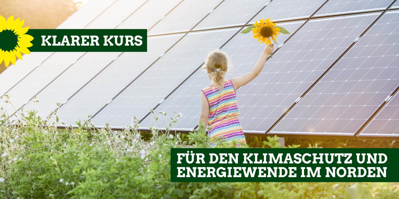 Solaranlage auf einer Wiese, davor ein Mädchen mit einer Sonnenblume in der Hand - Statement: Klarer Kurs für den Klimaschutz und Energiewende im Norden